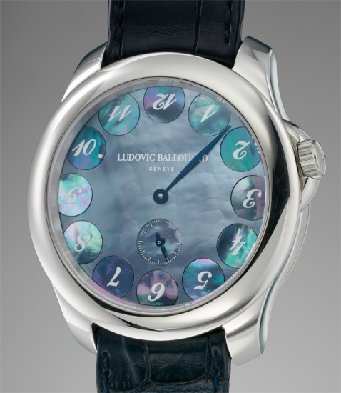 A unique, attractive and unusual jump hour platinum wristwatch with blue mother of pearl dial