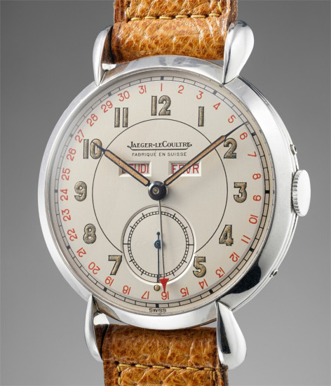 A very attractive stainless steel triple calendar wristwatch with tear drop lugs