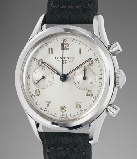 A rare and highly attractive stainless steel flyback chronograph wristwatch with silver dial