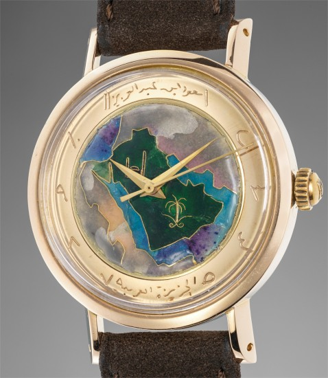 A rare and unusual pink gold wristwatch with cloisonné enamel dial depicting the Arabian peninsula