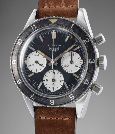 A very attractive stainless steel chronograph wristwatch with black dial and rotating bezel