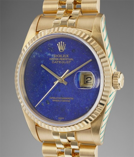 A fine and very rare yellow gold wristwatch with sweep center seconds, date and lapis lazuli dial