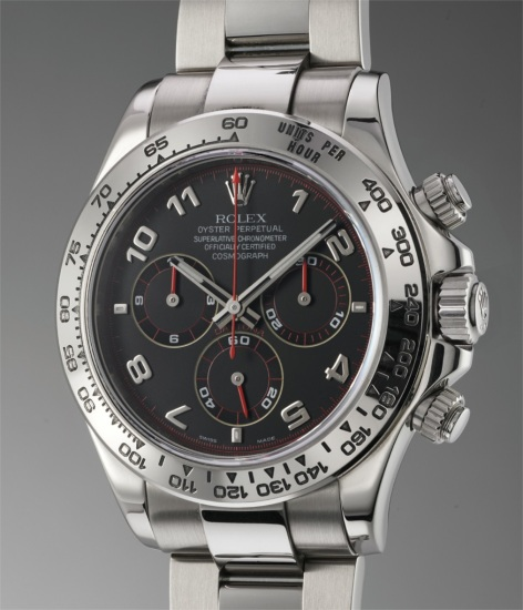 A rare and attractive white gold chronograph wristwatch with red accents on the dial and bracelet