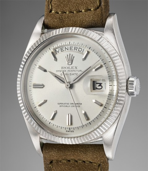 An extremely rare and early white gold calendar wristwatch with Italian day disc and reeded bezel