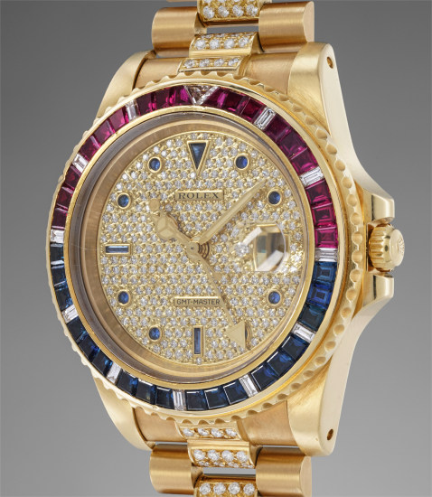 A highly rare and important yellow gold, diamond, ruby and sapphire-set dual time wristwatch with bracelet, made for the Sultanate of Oman