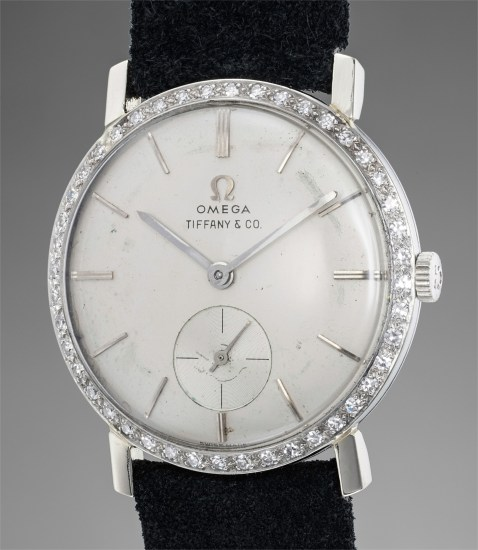 An attractive, rare, and historically important white gold wristwatch with diamond-set bezel and subsidiary seconds, retailed by Tiffany & Co.