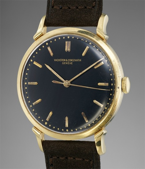 An extremely rare and attractive yellow gold wristwatch with center seconds and black dial