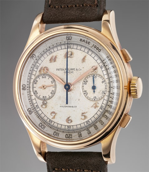 The only known, large and very attractive pink gold chronograph wristwatch with silver two-tone dial and Breguet numerals retailed by Hausmann & Co.