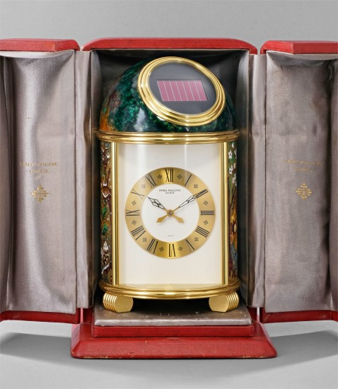 An extremely fine and unique gilt brass solar powered dome table clock with cloisonné enamel scene depicting Vivaldi's Four Seasons