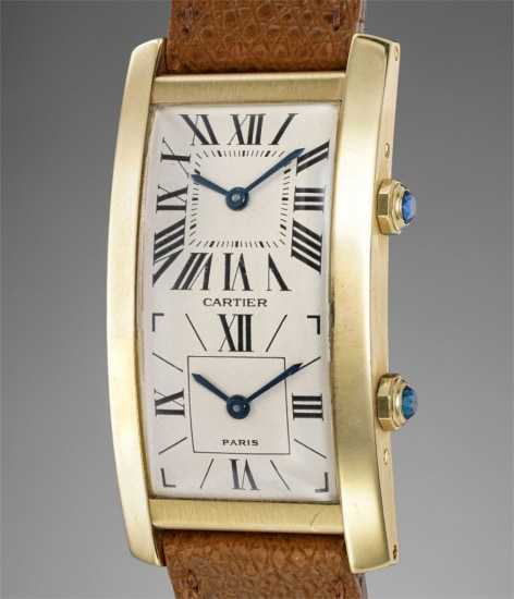 A fine and attractive rectangular yellow gold dual time wristwatch