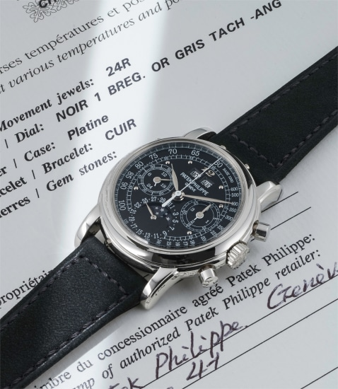 A highly rare and probably unique platinum perpetual calendar chronograph wristwatch with moonphases, black dial, Breguet numeral at 12 o'clock, tachymeter scale, original certificate, additional caseback and fitted presentation box