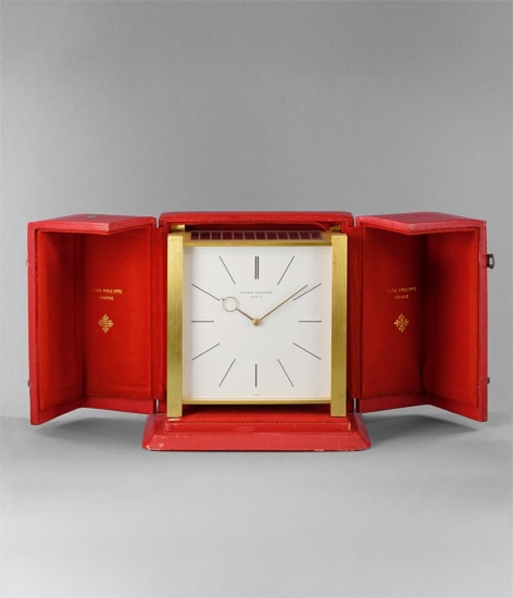 A fine and very rare solar-powered gilt brass table clock with box