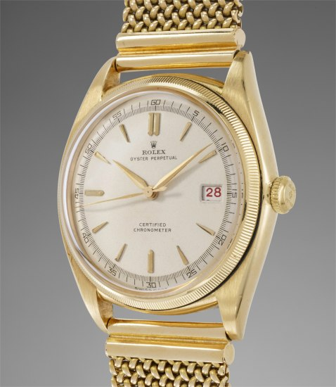 An attractive and early yellow gold wristwatch with center seconds, black and red roulette date wheel and bracelet
