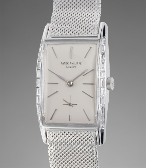 A rare and attractive platinum rectangular shaped wristwatch with diamond-set flared sides and silvered dial, formerly the property of Maurice Chevalier