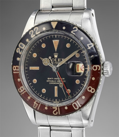 A rare and well-preserved stainless steel wristwatch with dual time, center seconds, bracelet and Bakelite bezel