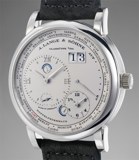 A very fine platinum dual time wristwatch with date, power reserve indication, Guarantee and box