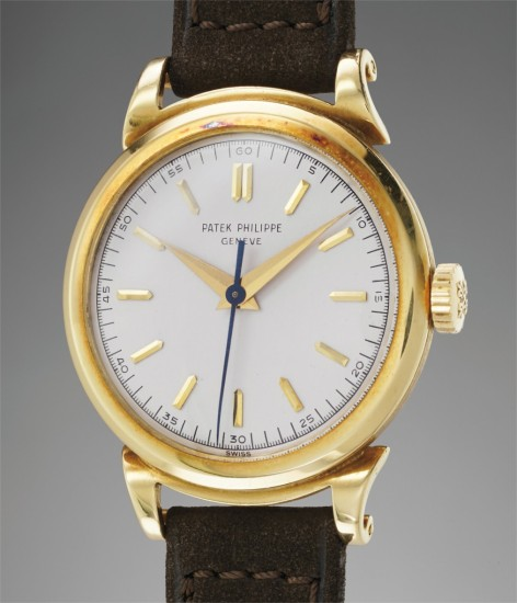 A rare and fine yellow gold wristwatch with center seconds, scroll lugs and fitted presentation box