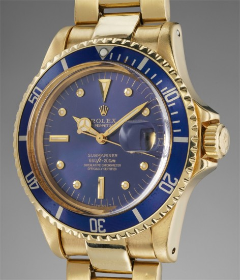 A fine and attractive yellow gold wristwatch with date, blue dial and bracelet