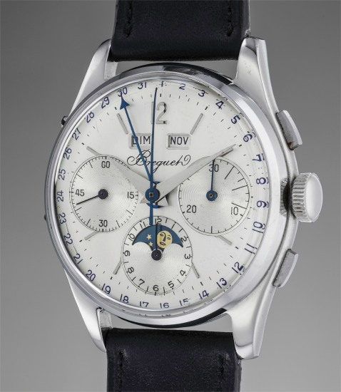An extremely rare and unusual stainless steel triple calendar chronograph wristwatch with moonphases
