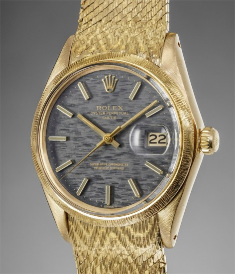 A fine, very attractive and unusual yellow gold wristwatch with center seconds, date, textured bezel, dial and bracelet