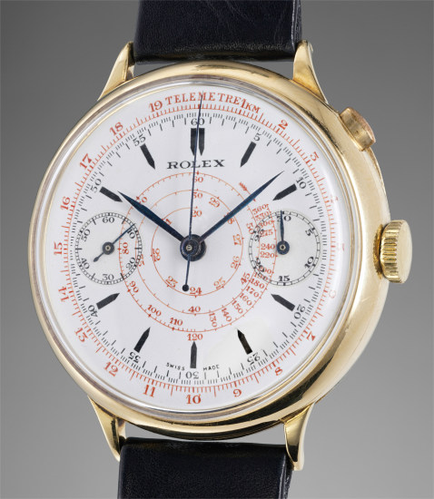 A very attractive and unusually large yellow gold single-button chronograph wristwatch with hinged case, enamel dial, telemeter and tachymeter scales