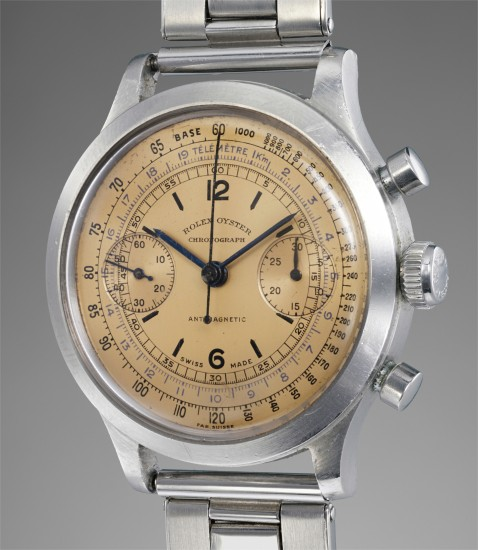 An extremely rare and highly attractive stainless steel chronograph wristwatch with salmon dial, tachymeter, telemeter scales and bracelet