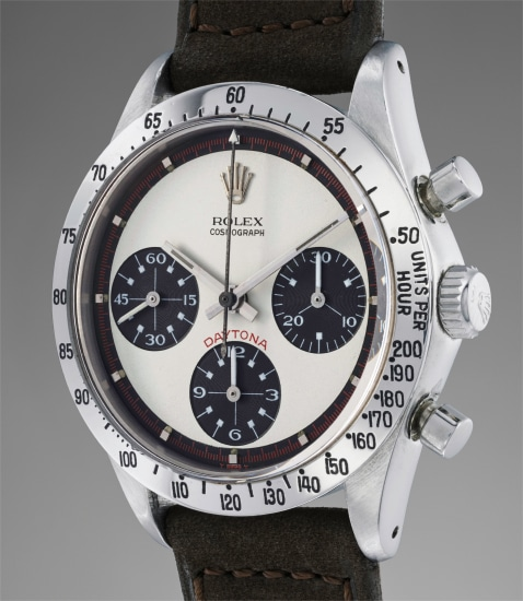 """A highly rare and most attractive stainless steel chronograph wristwatch with """"Paul Newman"""" dial, two additional bracelets and box"""