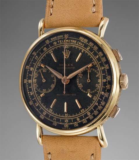 A very fine and very rare yellow gold chronograph wristwatch with black dial