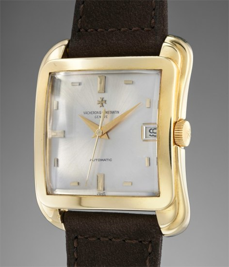 A fine and rare yellow gold oversized wristwatch with centre seconds silver dial and date