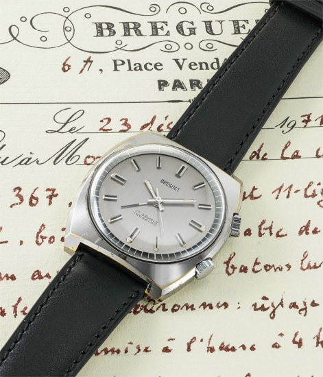 A rare and unusual chrome and stainless steel wristwatch with alarm