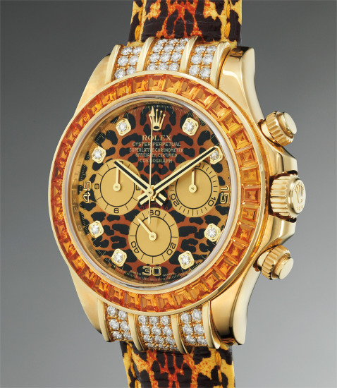 A rare, impressive and unusual yellow gold, diamond and yellow sapphire-set chronograph wristwatch