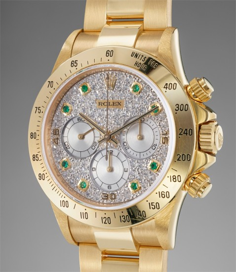 A very fine, rare and extremely attractive yellow gold, diamond and emerald-set chronograph wristwatch with bracelet and service guarantee card