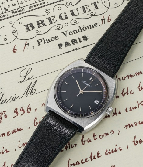 A rare stainless steel wristwatch with center seconds and date
