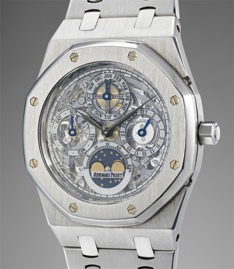 A rare and highly attractive stainless steel skeletonized perpetual calendar wristwatch with moonphases, bracelet and box