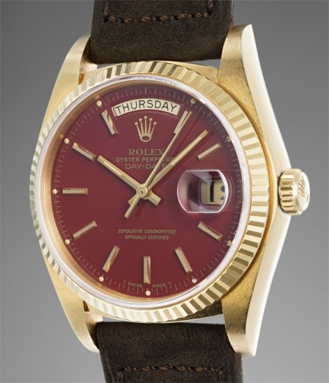 """A fine and attractive yellow gold calendar wristwatch with burgundy """"Stella"""" dial"""