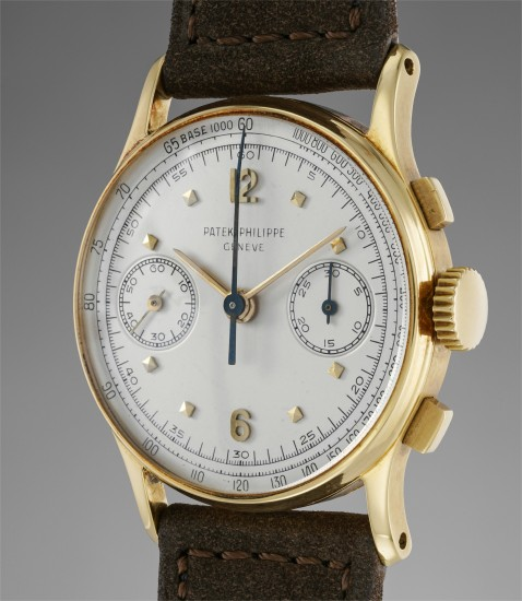 A fine and rare yellow gold chronograph wristwatch with silvered dial and tachymeter scale