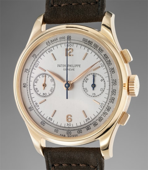 An extremely rare, important, attractive and large pink gold chronograph wristwatch with tow-tone dial, tachymeter scale and applied Arabic numerals