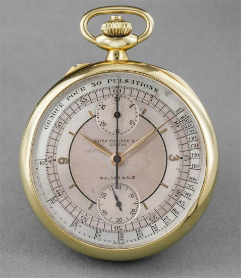 A rare, large and attractive yellow gold chronograph openface pocketwatch with two-tone sector dial, pulsations scale, presentation inscription to Benito E. Martinez and box, retailed by Walser Wald