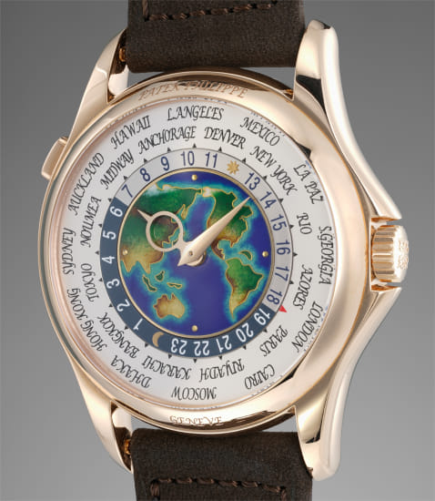A very fine and rare pink gold world time wristwatch with cloisonné enamel dial
