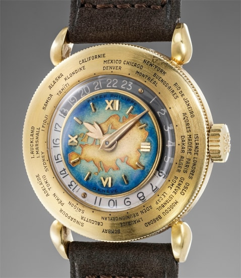 "An exceptionally fine, important and attractive yellow gold world time wristwatch with ""Eurasia"" polychrome cloisonné enamel dial"