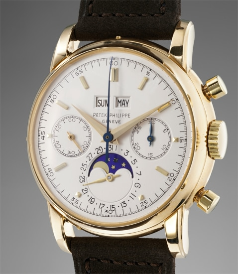 A rare and attractive yellow gold perpetual calendar chronograph wristwatch with moonphases