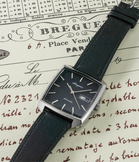 A fine and very rare stainless steel wristwatch with day and date