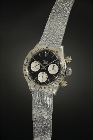 A historically important and exceedingly attractive white gold chronograph wristwatch with black dial and bark finished bracelet, the only one known of its kind