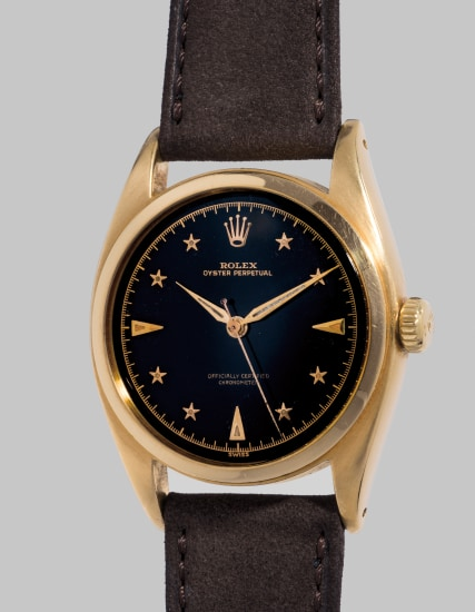 An extremely rare and beautiful wristwatch with sweep center seconds, star-set numerals, black lacquer dial and bracelet