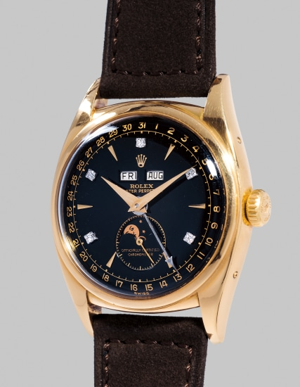 A spectacular and historically important yellow gold automatic triple calendar wristwatch with moonphases, black dial and diamond indexes