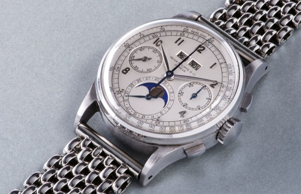 An extremely rare, highly attractive and historically important stainless steel perpetual calendar chronograph wristwatch with moon phases, applied arabic hour markers, tachymeter scale and bracelet