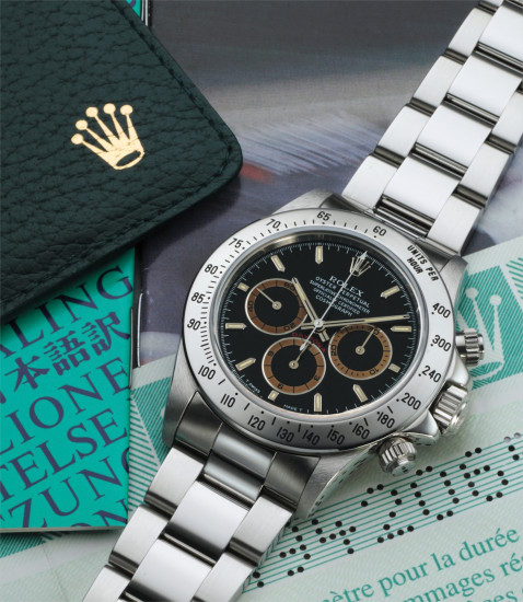 """A fine, rare and attractive stainless steel chronograph wristwatch with """"tropical"""" registers, bracelet and original guarantee"""