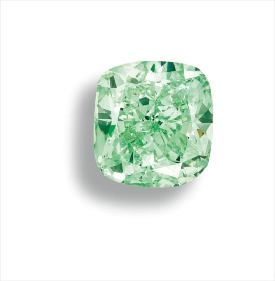 A Rare and Fine Fancy Intense Green Diamond and Diamond Ring