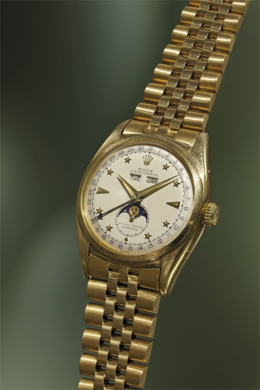 An exceptionally fine, rare and important yellow gold triple calendar wristwatch with star-set numerals, moon phases and bracelet