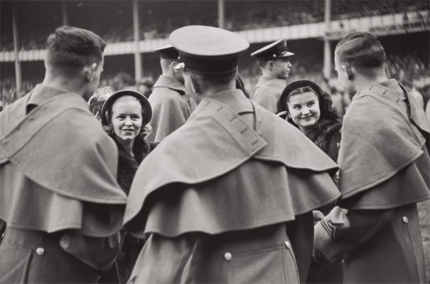 West Point cadets and their admiring young ladies attend the Army versus Notre Dame football game, New York